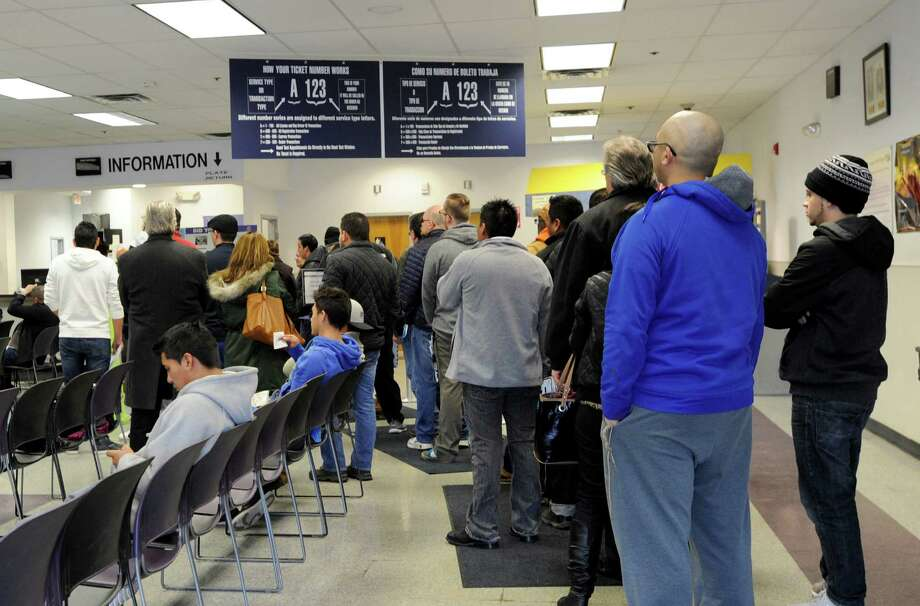 Customers wait in the information line at the State Department of Motor Vehicles in Danbury Tuesday, February 9, 2016. Photo: Carol Kaliff / Hearst Connecticut Media / The News-Times