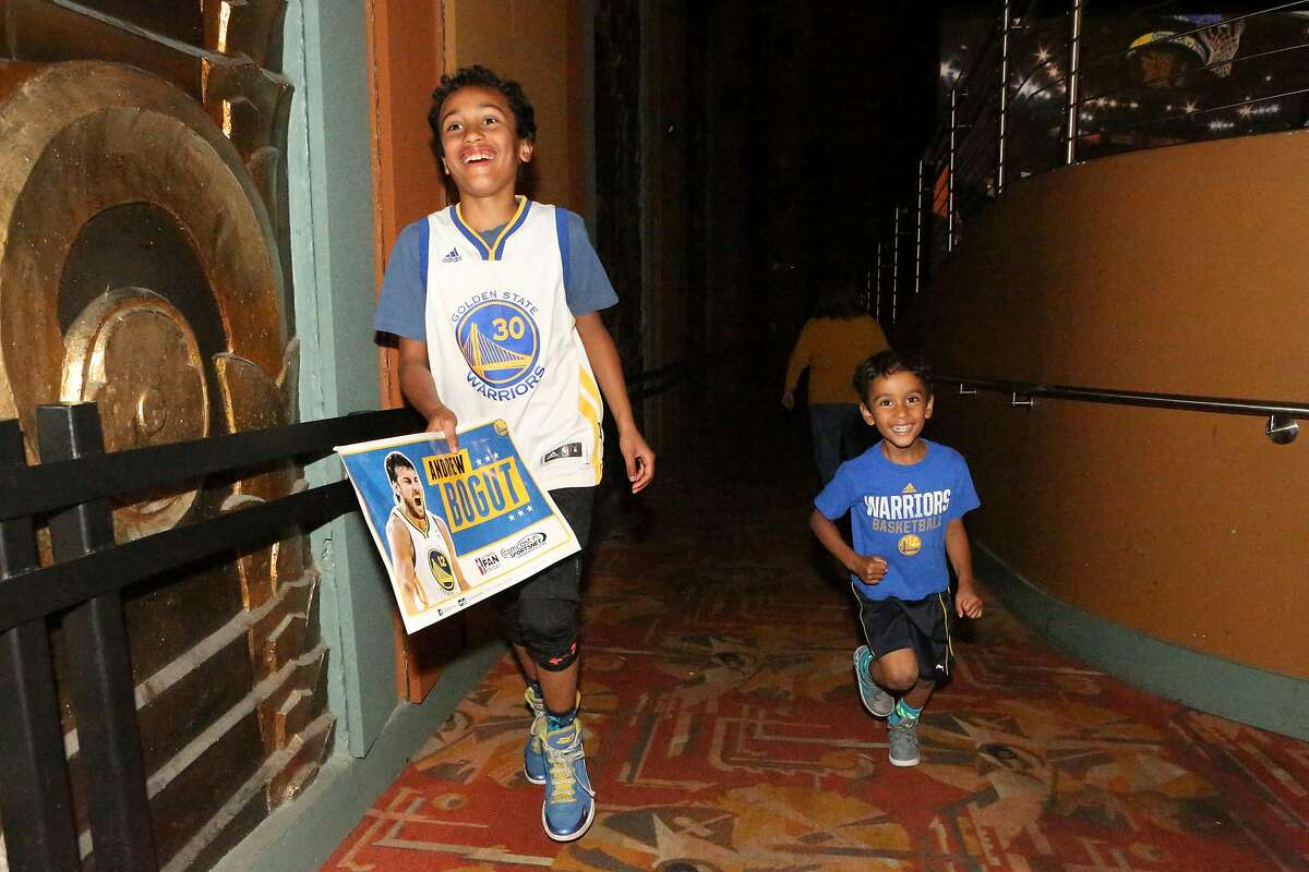 Brothers Julian Gibbs, 8, and Henrique, 3, run excitedly up and down the isles during half-time at the Alameda Theater on Monday, April 18, 2016.