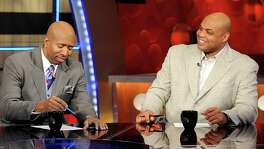 NBA basketball analysts Kenny Smith (left) and Charles Barkley are shown on the set at TNT studios in Atlanta in 2010.
