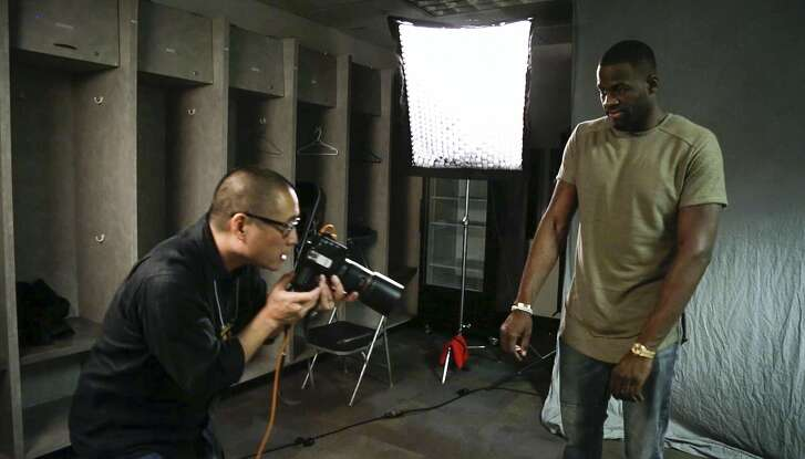 Russell Yip photographs Golden State Warrior Draymond Green's watch on Friday, March 25, 2016 in Oakland, Calif., at Oracle Arena in this still image from video.