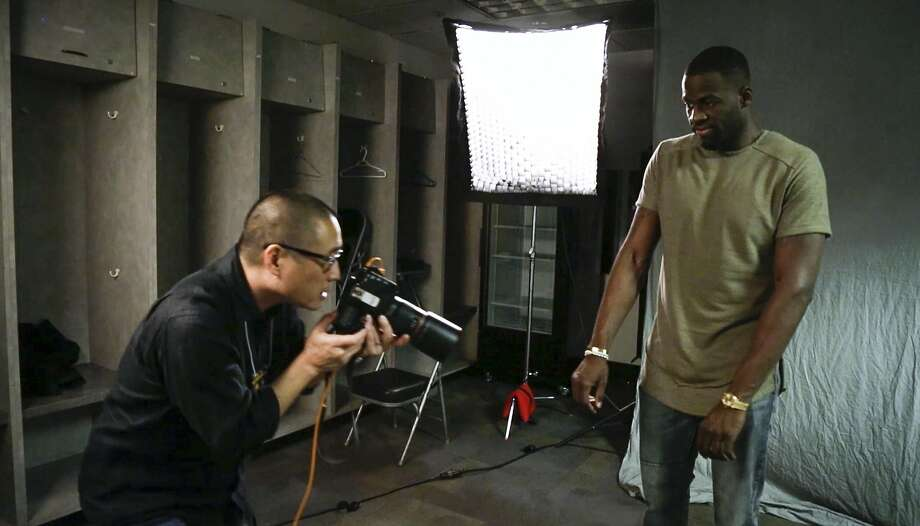 Russell Yip photographs Golden State Warrior Draymond Green's watch at Oracle Arena in this still image from video. Photo: Brian Feulner, Special To The Chronicle