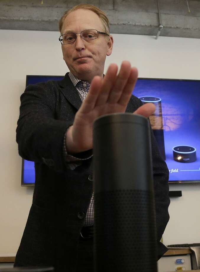In this Wednesday, March 2, 2016 photo, David Limp, Amazon Senior Vice President of Devices, gestures toward an Amazon Echo in San Francisco. Amazon.com is introducing two devices, the Amazon Tap and Echo Dot, that are designed to amplify the role that its voice-controlled assistant Alexa plays in people's homes and lives. (AP Photo/Jeff Chiu) Photo: Jeff Chiu, AP