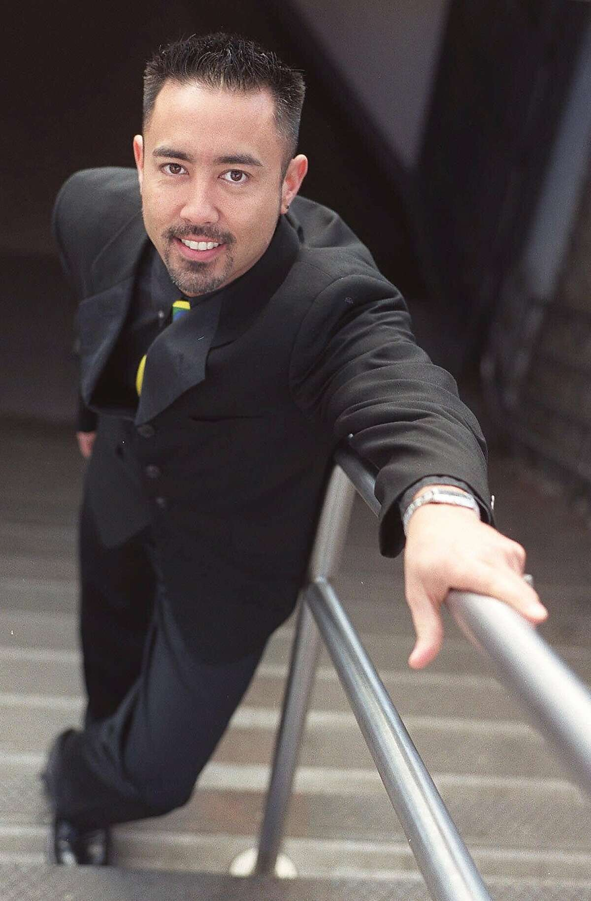 APN ADV. FOR SUN., APRIL 18--Countertenor Brian Asawa poses at a subway entrance on New York's Union Square, March 17, 1999. Asawa, 32, is among a small number of male singers to perform in the countertenor's high range, similar to the female mezzo-soprano voice. (AP Photo/Jim Cooper)