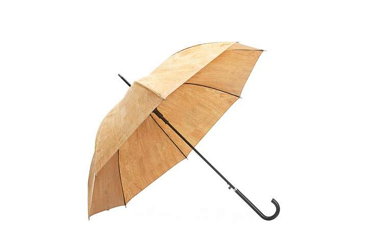 Cork umbrellas by Pelcor come in two styles, tall and short. The tall umbrella shown here is 41 inches in diameter and is 3 feet in length and retails for $158 ; a short, folding umbrella is 41 inches in diameter and 25 inches in length and retails for $148.