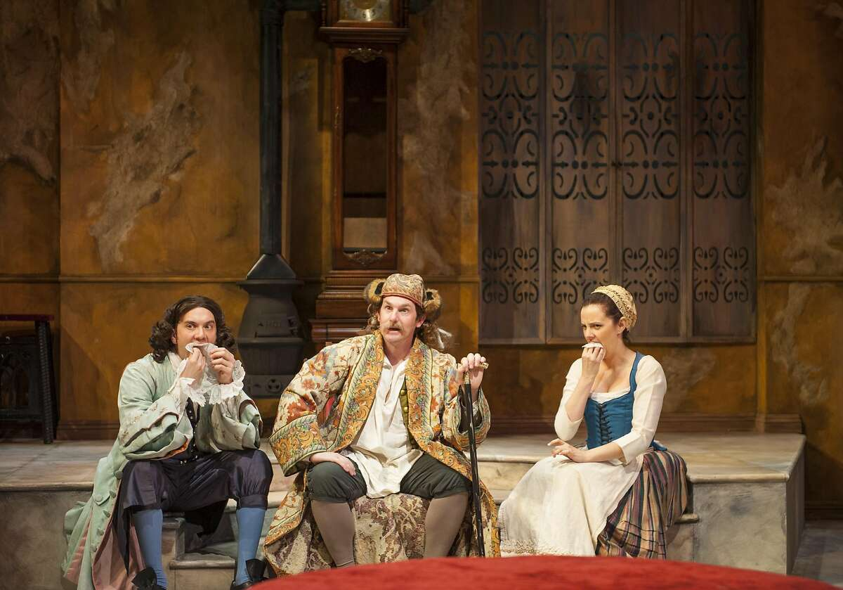 Imposter Geronte (Patrick Kelly Jones, center) orders Eraste (Kenny Toll, left) and Lisette (Katie Rubin) to eat his papers in Aurora Theatre Company�s