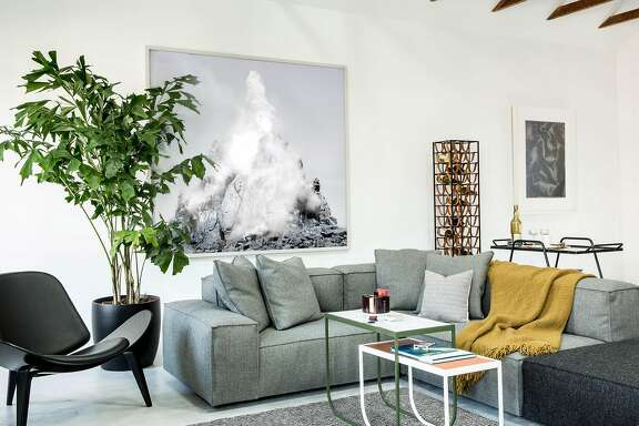 In a tech industry worker�s Mission District apartment, designer Lauren Geremia created a flexible space of new furniture and the owner�s prized possessions: his bike and computer.  Photo by Aubrie Pick