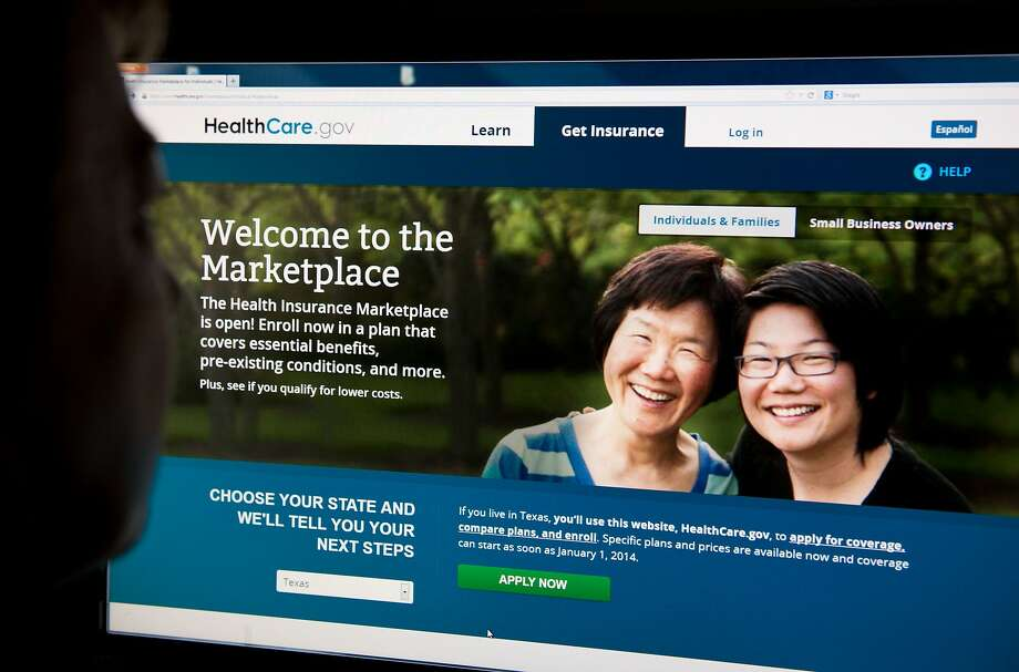 This file photo taken on October 1, 2013 shows a woman looking at the HealthCare.gov insurance exchange internet site  in Washington, D.C. Photo: KAREN BLEIER, AFP/Getty Images