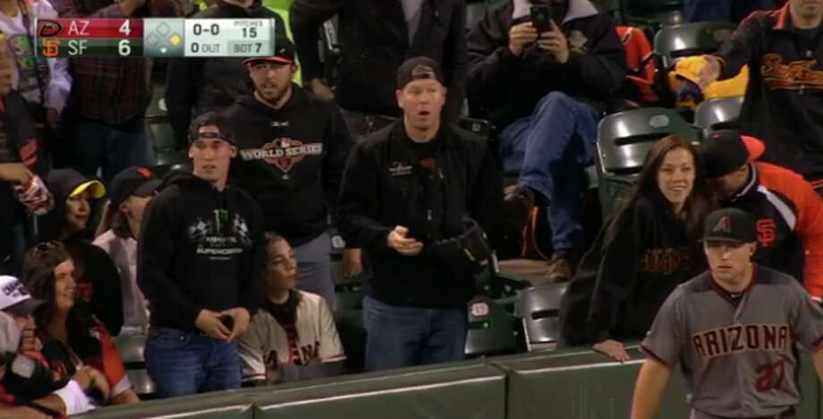 A San Francisco Giants fan reacts after he realized the ball he just grabbed was actually still in play. Photo: MLB.com