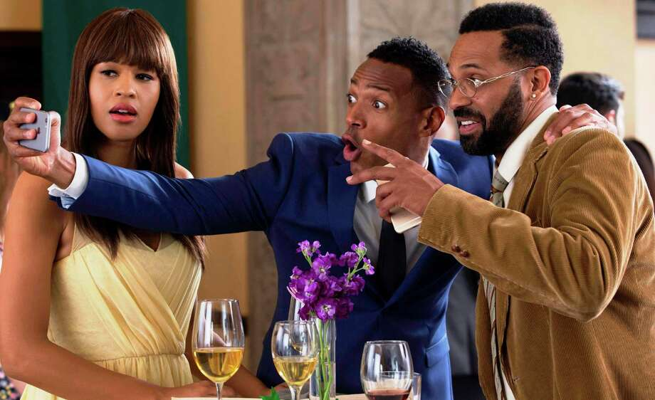"Kali Hawk (from left), Marlon Wayans and Mike Epps in ""Fifty Shades of Black,"" which tries hard to be more ridiculous than ""Fifty Shades of Grey."" Photo: Open Road Films"
