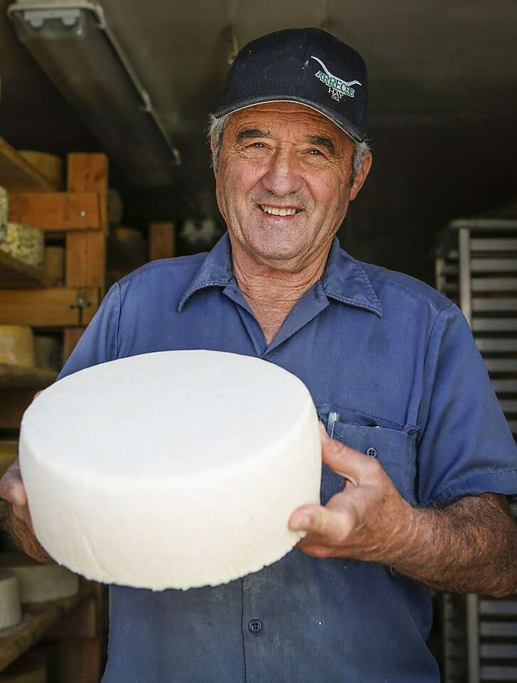 Dairyman Don DeBernardi holds a wheel of cheese at Two Rock Valley Goat Cheese on Thursday, April 2, 2015 in Petaluma, Calif.  The cheese will be aged before sale.