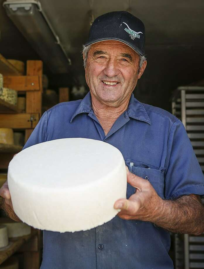 Dairyman Don DeBernardi holds a wheel of cheese at Two Rock Valley Goat Cheese in Petaluma. The cheese will be aged before sale. Photo: Russell Yip, The Chronicle