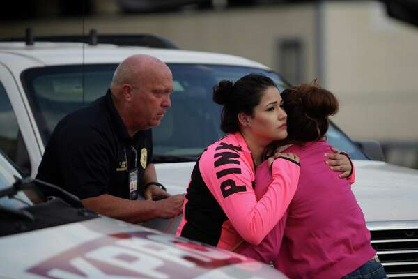 **************Prelim cutline ****will need editing A woman (far right) who believes that a body being recovered in a vehicle near the Westpark Tollway and Loop 610 is comforted as she reacts to news from law enforcement, Tuesday, April 19, 2016, in Houston.