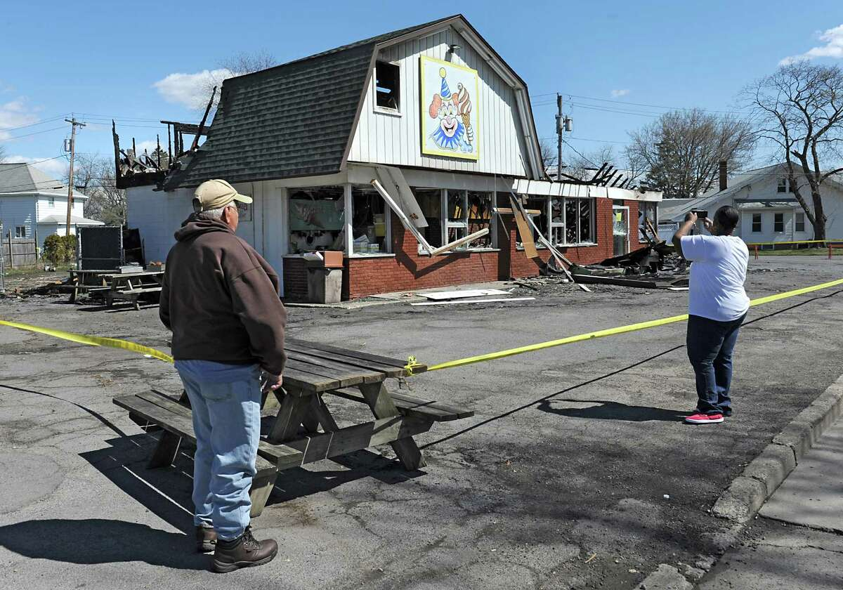 People take photos of Dairy Circus, a Scotia landmark that was destroyed by fire on Monday on Tuesday, April 19, 2016 in Scotia, N.Y. (Lori Van Buren / Times Union)