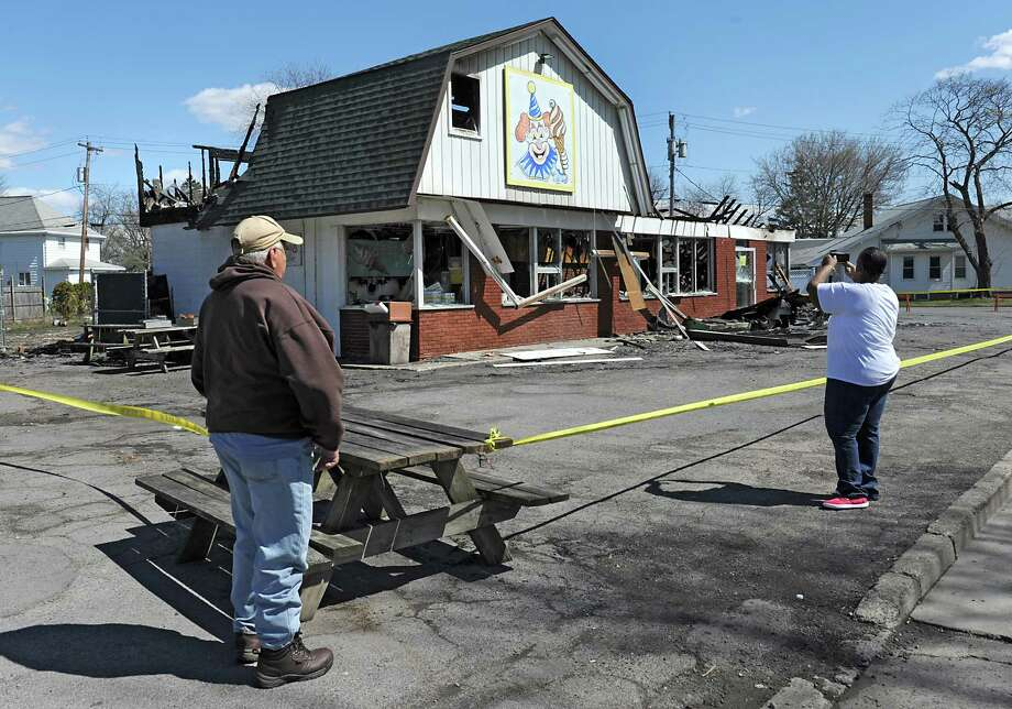 People take photos of Dairy Circus, a Scotia landmark that was destroyed by fire on Monday on Tuesday, April 19, 2016 in Scotia, N.Y. (Lori Van Buren / Times Union) Photo: Lori Van Buren / 10036249A