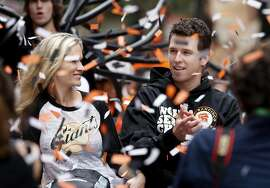 Buster Posey and his wife Kristen were covered by confetti as they road down Market Street. The San Francisco Giants celebrated their second World Series title in three years with a parade down Market Street Wednesday October 31, 2012.