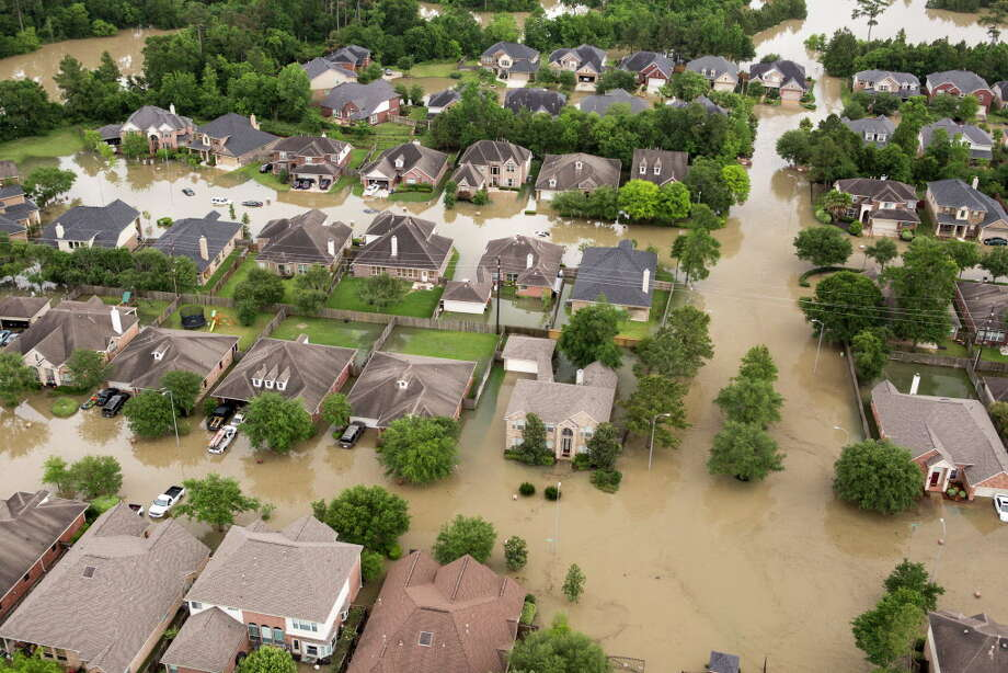 The Wimbledon Champions Park subdivision is inundated by floodwaters in the Cypresswood area on Tuesday, April 19, 2016, in Houston. Photo: Brett Coomer, Houston Chronicle / © 2016 Houston Chronicle