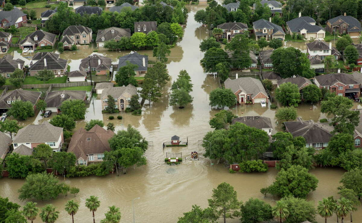 The Wimbledon Champions Park subdivision is inundated by floodwaters in the Cypresswood area on Tuesday, April 19, 2016, in Houston. (For more aerial photos of recent flooding -- and of the wetlands that help prevent it -- scroll through the gallery.)