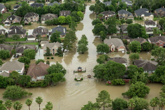 The Wimbledon Champions Park subdivision is inundated by floodwaters in the Cypresswood area on Tuesday, April 19, 2016, in Houston.