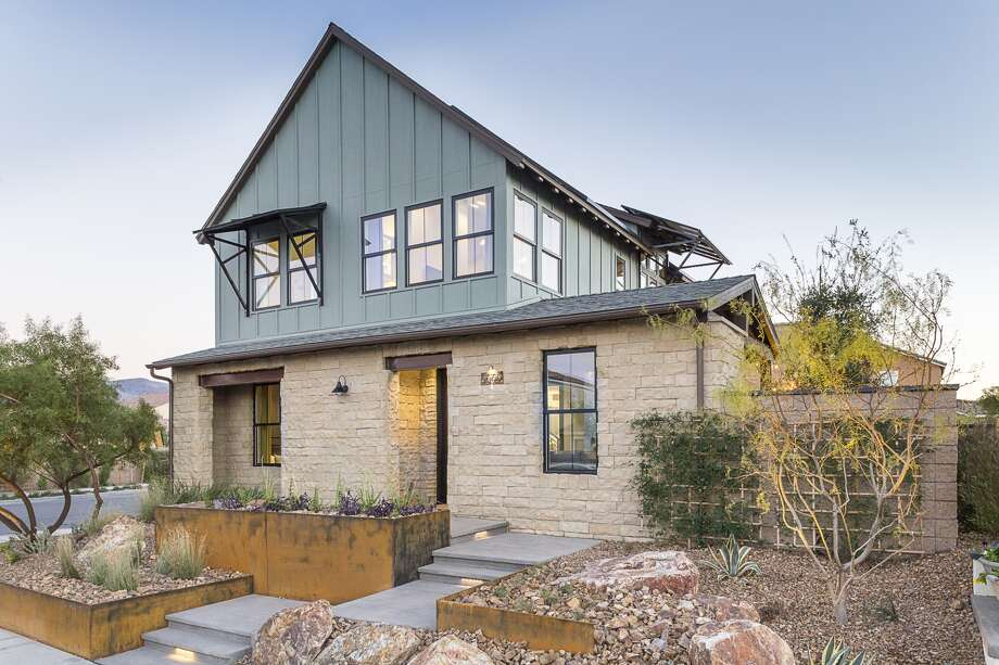 Modern ranch aesthetics trades extra rooms for outdoor for Thornton builders modern farmhouse plan
