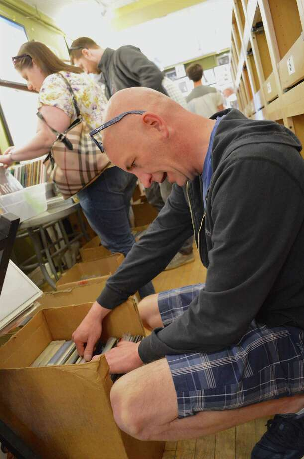 Doug Plourd of Tolland believes that newer artists today recognize the value of long-playing records. Photo: Jarret Liotta / Hearst Connecticut Media / Darien News  freelance