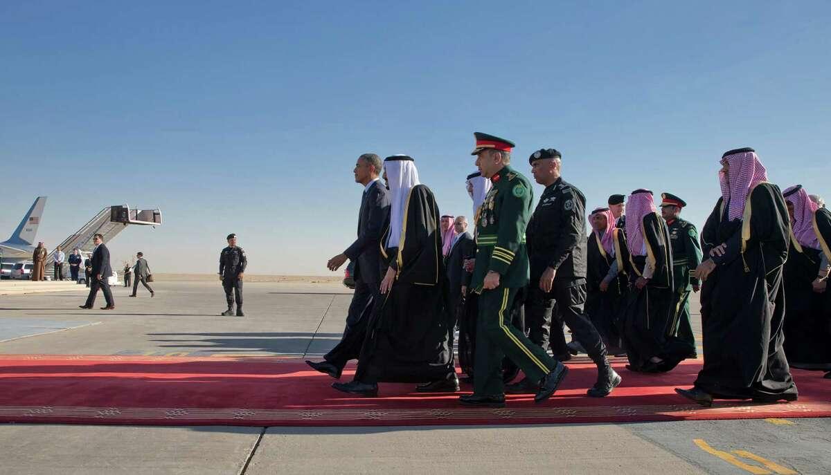President Barack Obama walks with Saudi King Salman bin Abdulaziz Al Saud at Riyadh's airport in January 2015.