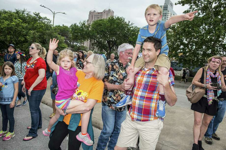 From left, Alison Baldwin, 5, Laurie Reasonover, David Reasonover, Reed Baldwin, 7, and his father Randy Baldwin, enter with Julie Baldwin (not pictured) and son Jake, 2, (not pictured) into La Villita for the start of NIOSA during Fiesta week in San Antonio, Texas on Tuesday, April 19, 2016. Photo: Matthew Busch /For The Express-News / © Matthew Busch