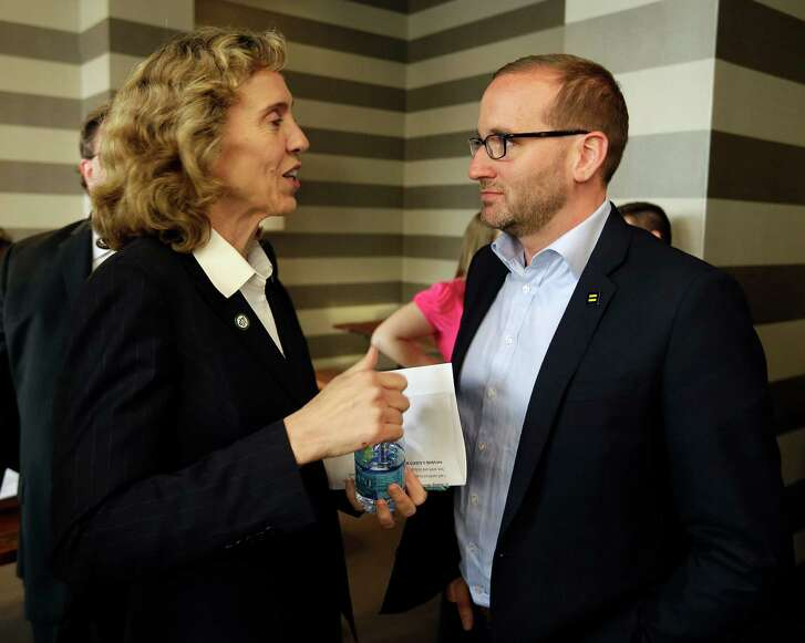 Charlotte Mayor Jennifer Roberts meets with Chad Griffin, president of the Human Rights Campaign, before a town hall meeting Thursday in Charlotte, N.C. Mayors in the state's large cities say they're being pummeled by both sides.