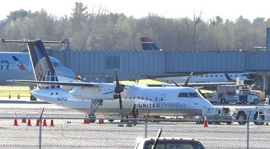 A United commuter jet sits at the gate at Albany International Airport Wednesday morning after a passenger spoke of a bomb on the flight and the pilot ordered the plane evacuated. (Skip Dickstein / Times Union)