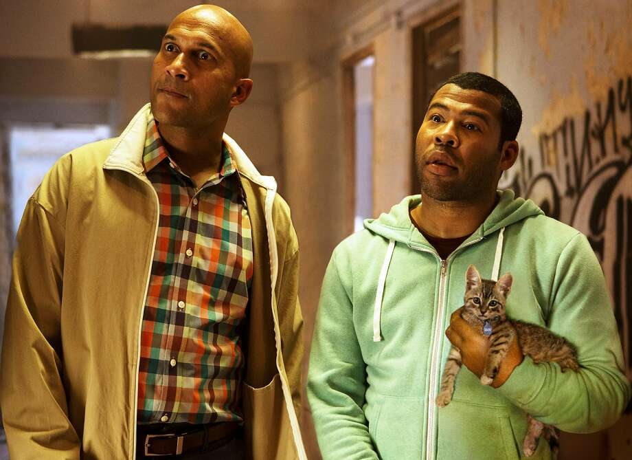 """Keegan-Michael Key (left) and Jordan Peele play cousins who must infiltrate the criminal underworld to rescue a kitten in """"Keanu."""" The popular comedy duo's television show has ended its run, and the two men will be working on solo projects. Photo: Steve Dietl, Warner Bros. Pictures"""