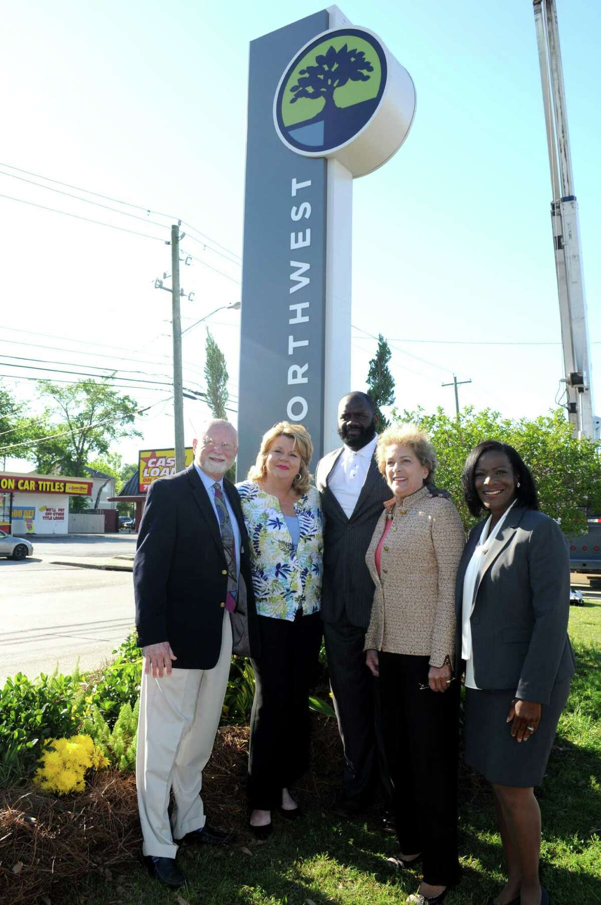 Northwest Management District Board President Wayne Norden, left, District A councilwoman Brenda Stardig, District B councilman Jerry Davis, District C councilwoman Ellen Cohen and NMD boardmember Marvalette Hunter gather at the base of the a sign for Northwest Management District rebranding project. unveiling.Northwest Management District Board President Wayne Norden, left, District A councilwoman Brenda Stardig, District B councilman Jerry Davis, District C councilwoman Ellen Cohen and NMD boardmember Marvalette Hunter gather at the base of the a sign for Northwest Management District rebranding project. unveiling.