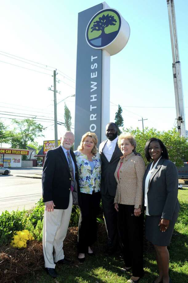 Northwest Management District Board President Wayne Norden, left, District A councilwoman Brenda Stardig, District B councilman Jerry Davis, District C councilwoman Ellen Cohen and NMD boardmember Marvalette Hunter gather at the base of the a sign for Northwest Management District rebranding project. unveiling.Northwest Management District Board President Wayne Norden, left, District A councilwoman Brenda Stardig, District B councilman Jerry Davis, District C councilwoman Ellen Cohen and NMD boardmember Marvalette Hunter gather at the base of the a sign for Northwest Management District rebranding project. unveiling. / George Wong -Freelance
