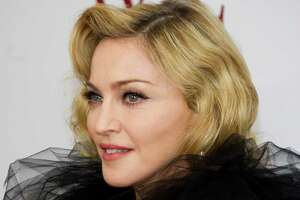 "Madonna attends the premiere of ""W.E."", hosted by the Weinstein Company and The Cinema Society, in New York, Monday, Jan. 23, 2012. (AP Photo/Charles Sykes)"