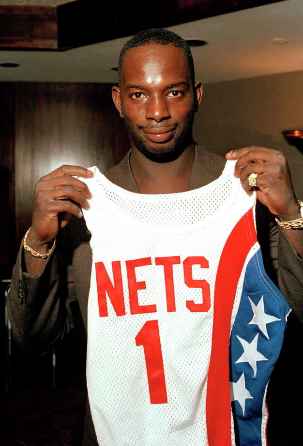 """FILE - In this Aug. 20, 1986 file photo, Dwayne """"Pearl"""" Washington, the first draft pick by the New Jersey Nets, holds up his new uniform during a press luncheon at the Meadowlands Arena in East Rutherford, N.J.  Washington, who went from New York City playground wonder to Big East star for Jim Boeheim at Syracuse, has died. He was 52. Washington died Wednesday, April 20, 2015 of cancer, the university said.  (AP Photo/Ron Frehm, File) ORG XMIT: NY803 Photo: Ron Frehm / AP"""