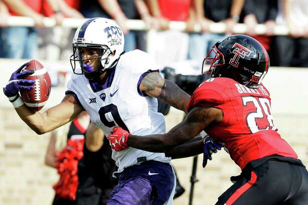 TCU wide receiver Josh Doctson (9) catches a touchdown pass against Texas Tech defensive back Paul Banks (28) during the first half of an NCAA college football game Saturday, Sept. 26, 2015, in Lubbock.