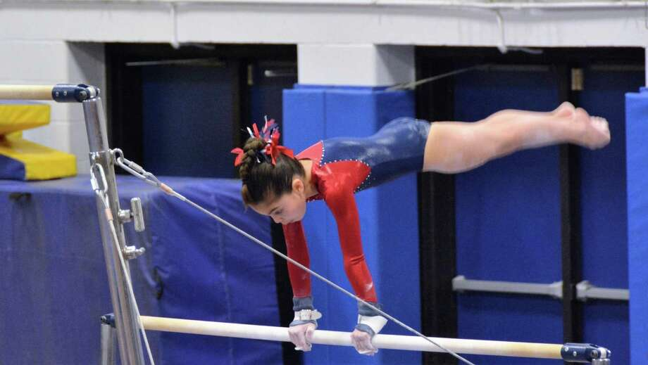 Darien YMCA Level 5 gymnast Sophia DeStefano scored 9.4 on her bar routine at the 2016 State Championships. Photo: Contributed / Darien News