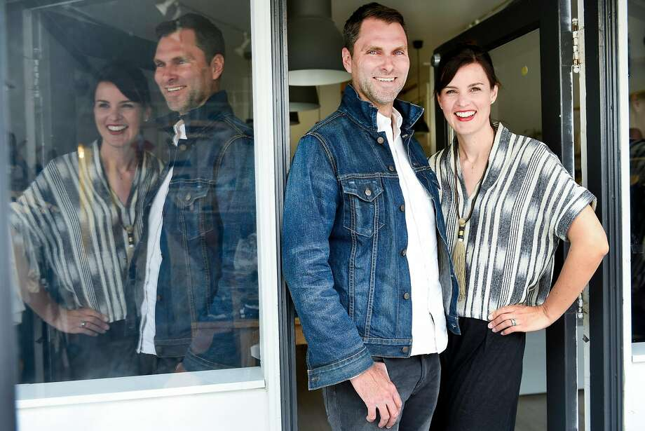 Josh and Lauren Podoll recently celebrated the one-year anniversary of their shop in the Noe Valley neighborhood, where they also live. Their wares include pocket knives, left, as well as clothing, design items and leather goods, above. And the couple make room for artwork, such as the row of wool fiber sculptures, above the leather goods, by local artist Meghan Shimek. Photo: Michael Short, Special To The Chronicle