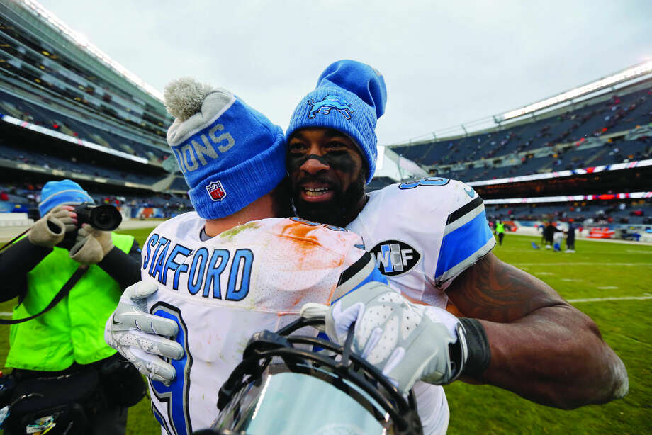 Detroit Lions quarterback Matthew Stafford (9) hugs wide receiver Calvin Johnson (81) after an NFL football game against the Chicago Bears, Sunday, Jan. 3, 2016, in Chicago. The Lions won 24-20. (AP Photo/Charles Rex Arbogast) Photo: Charles Rex Arbogast