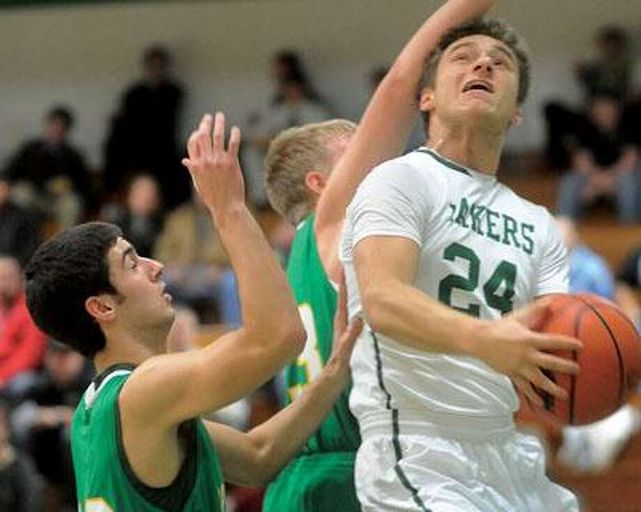 EPBP's Aaron Christy (24) goes hard to the basket against a pair of Brown City defenders in the first quarter.