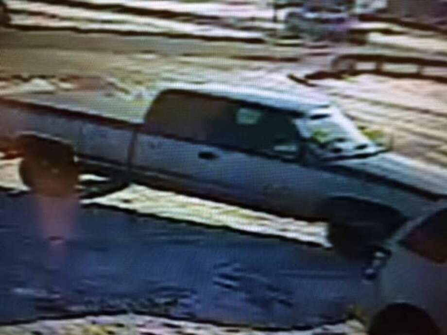 This picture, which the St. Clair County Sheriff's Office says it obtained from video from a business near the bank, shows the suspect's vehicle, a dark blue Chevy truck with light blue tailgate.
