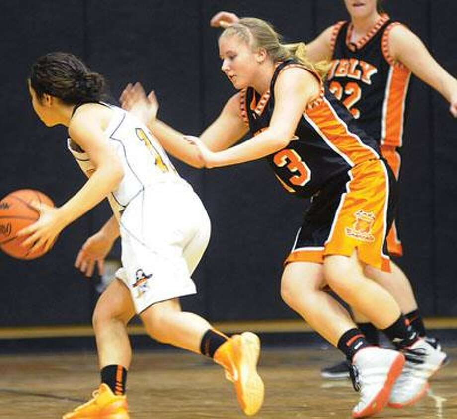 Harbor Beach's Haleemah Aqel drives against Ubly's Nicole Sweeney (13) in the first half.