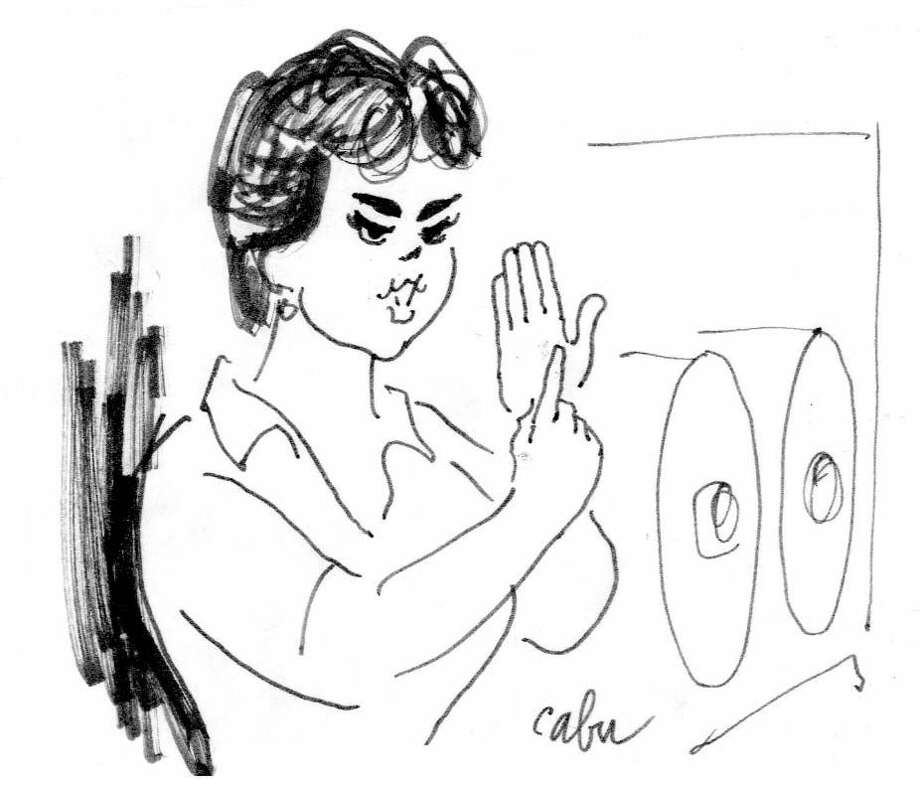 Former Huron Daily Tribune reporter and editor Sandy Sutton was drawn by Jean Cabut during Cabut's visit to Bad Axe in 1988. She is describing the Thumb, and there are rolls of newsprint behind her. Cabut, who went by the pen name of Cabu, was among the newspaper employees killed this week in a terrorist attack in Paris, France.