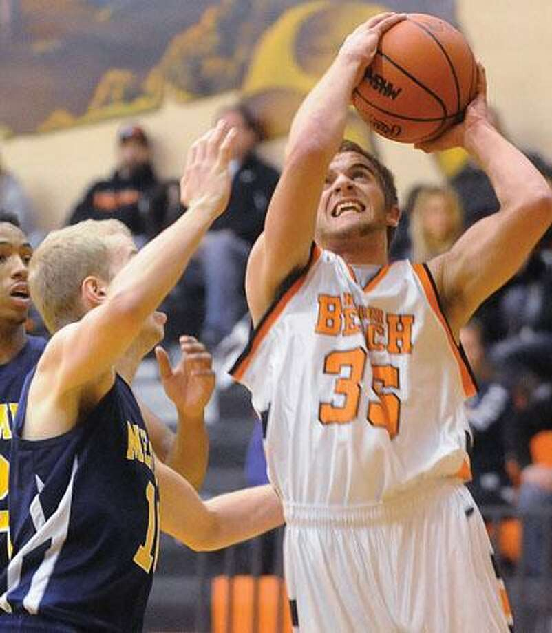 Harbor Beach's Colin Cook (35) puts up a shot against Memphis' Colton Gmerick in the first quarter.