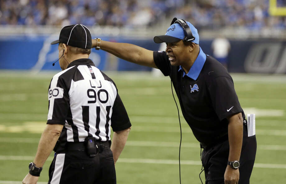 FILE - In this Dec. 27, 2015, file photo, Detroit Lions head coach Jim Caldwell, right, disputes a call with line judge Mike Spanier (90) during the first half of an NFL football game against the San Francisco 49ers in Detroit. Caldwell might be giving himself a chance to coach the Lions for a third season, helping his team win five of seven to guarantee he will have a winning mark with the franchise. (AP Photo/Carlos Osorio, File) Photo: Carlos Osorio