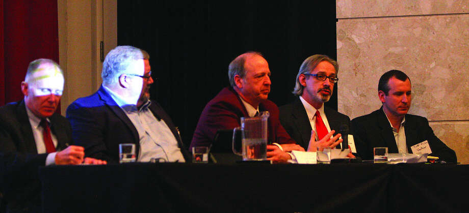 """Carl Osentoski, executive director of Huron County Economic Development Corp., second from right, speaks to about 100 people during a """"Huron County Case Study"""" at a state wind forum at Michigan State University on Tuesday. Other panelists, from left, are Matt Wagner of DTE Energy, David Shiflett of Geronimo Energy, County Commissioner David Peruski and Scott Viciana of Ventower. Photo: Chris Aldridge/Huron Daily Tribune"""