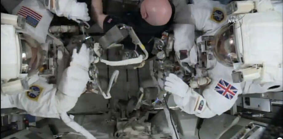 This photo taken from video provided by NASA shows astronaut Scott Kelly, center, help gather equipment for U.S. astronaut Tim Kopra, left, and British astronaut Tim Peake, as they prepare for a space walk at the International Space Station on Friday, Jan. 15, 2016. Peake will become the first Briton to walk in space when he ventures out of the International Space Station (ISS) to help repair a broken power unit. (NASA via AP) Photo: HOGP