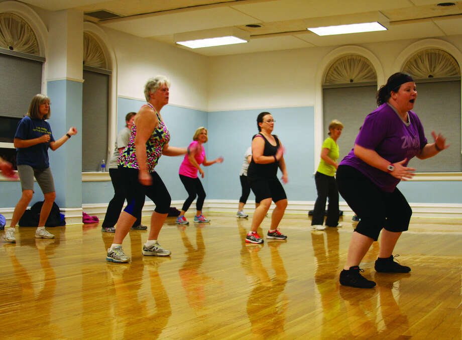 FitMix instructor Gina Knoblock helps lead Thursday night's FitMix class. FitMix is a 60-minute fitness class that combines fun songs, dancing and fitness moves to get that tone body you're looking for. Knoblock is accompanied each week by two other teachers, Jamie Wood and Gretchen Woodke, for the hour-long workout. Classes are held every Tuesday and Thursday from 6 to 7 p.m. at the Harbor Beach Community House Commons Room. Drop-ins are $8; twice a week is $6 per session; and once a week is $7 per session. For newcomers, the first class is free of charge. For additional information or to sign up for a class, contact Jamie Wood at 989-315-1302 or Gretchen Woodke at 989-712-0295. Classes will not meet on Jan. 19 and Feb. 9.