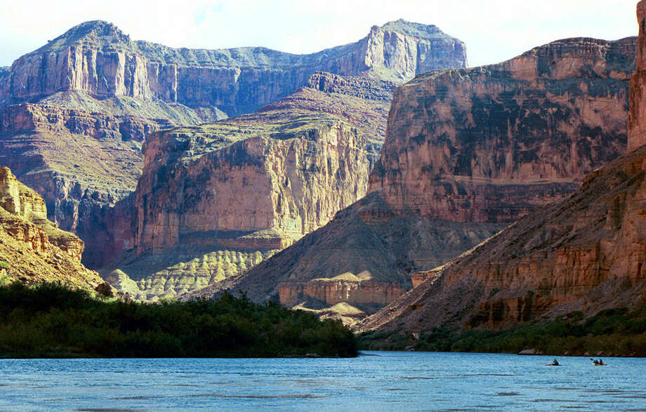 FILE - This Aug. 29, 2002 file photo, shows the Colorado River at the Grand Canyon National Park, in Arizona. A new report by a federal watchdog outlines a history of sexual harassment on river rafting trips run by Grand Canyon National Park. The report obtained by The Associated Press comes after 13 current and former park employees filed a complaint in 2014 saying women had been abused. It's set to be released later Tuesday, Jan. 12, 2016, by the Department of the Interior's Office of Inspector General. (AP Photo/Brian Witte, File) Photo: Brian Witte