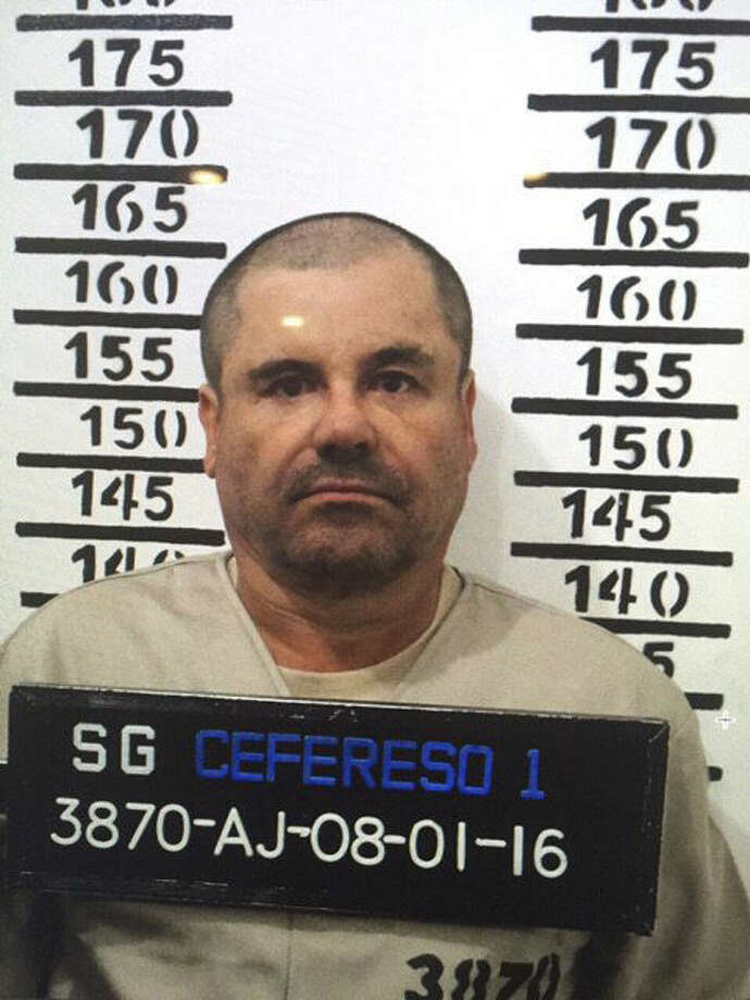"""In this Jan. 8, 2016 image released by Mexico's federal government, Mexico's most wanted drug lord, Joaquin """"El Chapo"""" Guzman, stands for his prison mug shot with the inmate number 3870 at the Altiplano maximum security federal prison in Almoloya, Mexico. Mexico has begun the process of extraditing Guzman to the United States, where he faces drug-trafficking charges, but that could take """"a year or longer"""" because of legal challenges, according to the head of Mexico's extradition office, Manuel Merino. He cited one extradition case that took six years. (Mexico's federal government via AP) Photo: HOGP"""