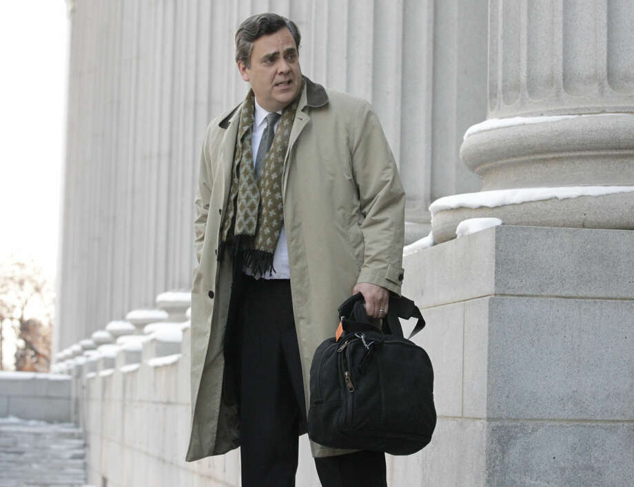 """FILE - In this Jan. 17, 2013, file photo, Jonathan Turley, attorney for Kody Brown and his four wives, the stars of the reality show """"Sister Wives,"""" leaves the Frank E. Moss United States Courthouse, in Salt Lake City. Lawyers for a family made famous by the TV show """"Sister Wives"""" are set to ask a federal appeals court to uphold a ruling that decriminalized polygamy in Utah. The case is scheduled to come before the 10th Circuit Court of Appeals in Denver on Thursday, Jan. 21, 2016. (AP Photo/Rick Bowmer, File) Photo: Rick Bowmer"""