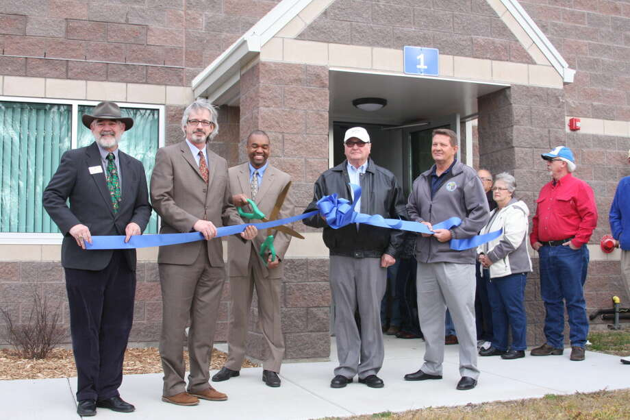 Officials gather at a recent ribbon-cutting ceremony honoring the new service center.